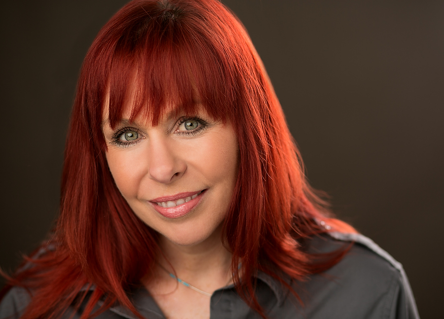 Headshot of  a lady with red hair